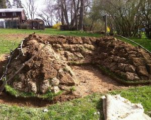 U shaped Hugel - raised bed. Utilize a lot of wood and produce a lot of herbs and greens.